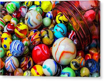 Red Jar Spilling Marbles Canvas Print by Garry Gay