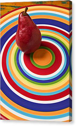 Red Pear On Circle Plate Canvas Print by Garry Gay