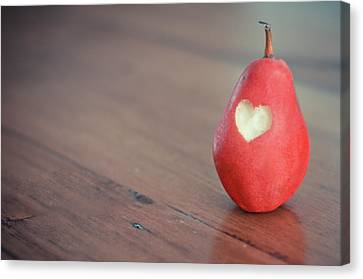 Red Pear With Heart Shape Bit Canvas Print by Danielle Donders - Mothership Photography
