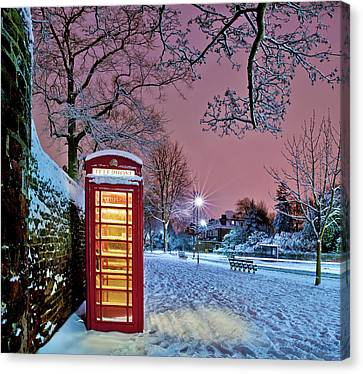 Red Phone Box Covered In Snow Canvas Print by Photo by John Quintero