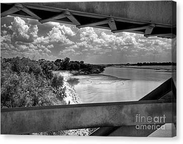 Red River Bridge View Canvas Print by Fred Lassmann