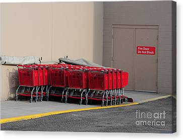 Red Shopping Carts In A Row Canvas Print by Merrimon Crawford