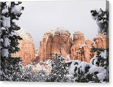 Red Towers Under Snow Canvas Print