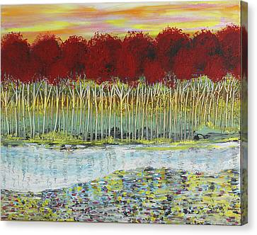 Red Trees At Water Canvas Print by Sima Amid Wewetzer