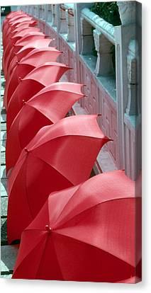 Red Umbrellas Canvas Print by Douglas Pike