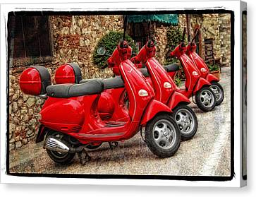 Red Vespas Canvas Print by Mauro Celotti