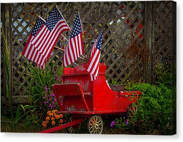 Red Wagon With Flags Canvas Print by Garry Gay