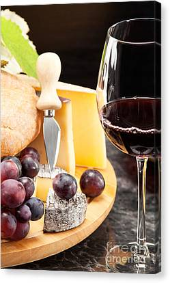 Red Wine With Wine Grapes Canvas Print by Wolfgang Steiner