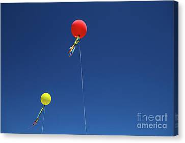 Canvas Print featuring the photograph Red,yellow Balloon Blowing By The Wind In The Air With The Blue  by Jingjits Photography