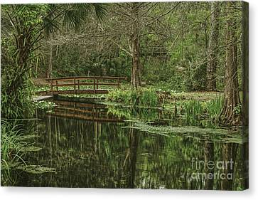 Reflected Bridge Canvas Print by Marvin Reinhart