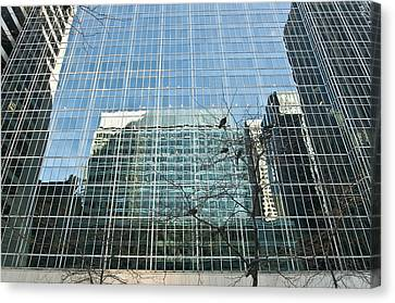 Reflected Buildings Canvas Print by Svetlana Sewell