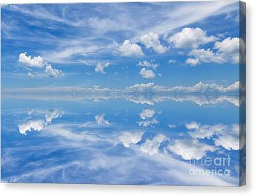 Reflection Of Beautiful Blue Sky With Clouds Canvas Print by Caio Caldas