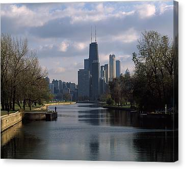 Lincoln Park Lagoon Canvas Print - Reflection Of Buildings In A Lagoon by Panoramic Images