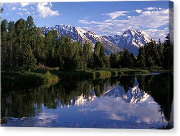 Reflection Of The Teton Mountans Canvas Print by Richard Nowitz