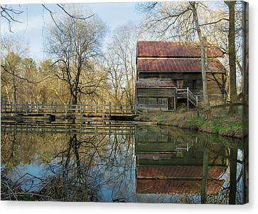 Reflection On A Grist Mill Canvas Print by George Randy Bass