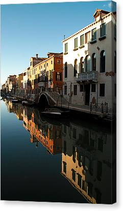 Reflection On The Cannaregio Canal In Venice Canvas Print by Michael Henderson