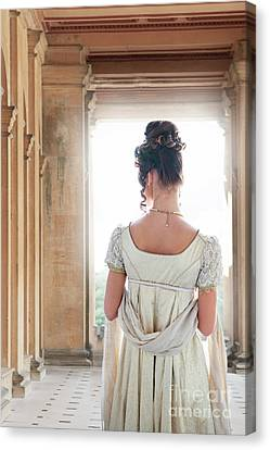 Canvas Print featuring the photograph Regency Woman Under A Colonnade by Lee Avison
