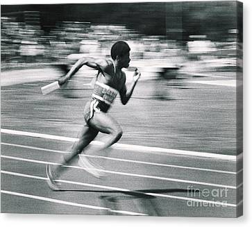 Relay Runner Canvas Print by Jim Wright