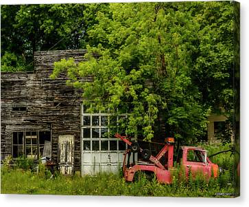 Remains Of An Old Tow Truck And Garage Canvas Print by Ken Morris