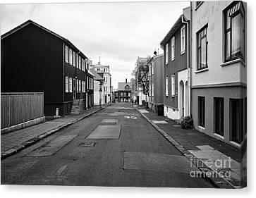 Residential Street With Multi Storey Corrugated Iron Clad Buildings Reykjavik Iceland Canvas Print by Joe Fox