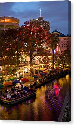 Restaurant Along A River Lit Canvas Print by Panoramic Images