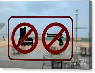 Restaurant Entrance Door With 'firearms' And 'roller-skates' For Canvas Print by Sami Sarkis