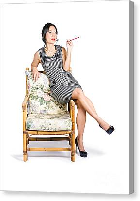 Retro Woman On Lounge Chair With Cigarette Holder Canvas Print by Jorgo Photography - Wall Art Gallery