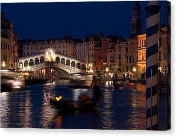 Rialto Bridge In Venice At Night With Gondola Canvas Print by Michael Henderson