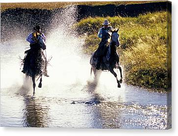 Riders In A Creek Canvas Print by Inga Spence
