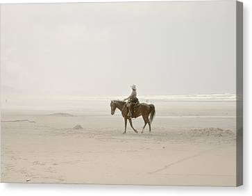 Canvas Print featuring the photograph Riding On The Beach by Craig Perry-Ollila