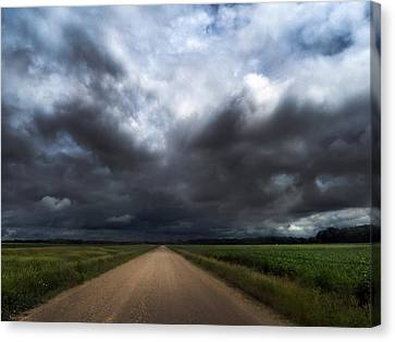 Riding Into Dark Clouds Canvas Print by Eric Benjamin
