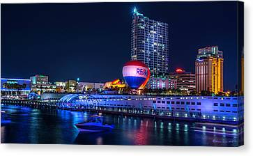 Riverfront Balloons Canvas Print by Marvin Spates