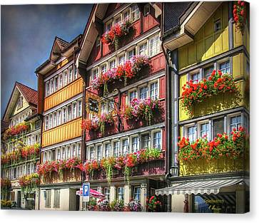 Canvas Print featuring the photograph Row Of Swiss Houses by Hanny Heim