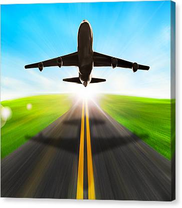 Road And Plane Canvas Print by Setsiri Silapasuwanchai