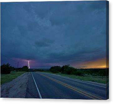 Canvas Print featuring the photograph Road To The Storm by Ed Sweeney