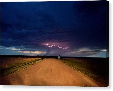 Canvas Print featuring the photograph Road Under The Storm by Ed Sweeney