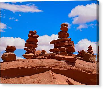 Rock Cairns In The Desert Canvas Print by Dany Lison