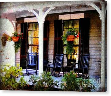 Rocking Chairs On A Country Porch  Canvas Print by Janine Riley