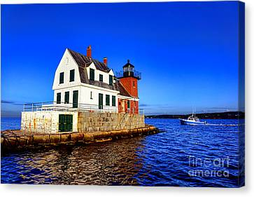 Rockland Harbor Light And Fishing Boat Canvas Print by Olivier Le Queinec