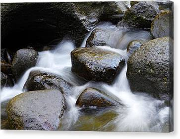 Rocks In Stream Canvas Print by Les Cunliffe