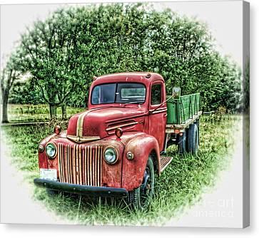 Rocks Old Truck Canvas Print by Pamela Baker