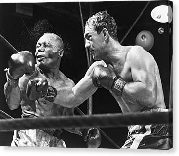 1950s Portraits Canvas Print - Rocky Marciano Landing A Punch by Everett