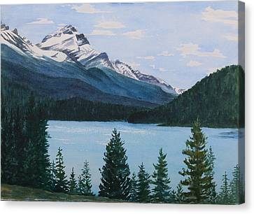 Rocky Mountains Canvas Print by Debbie Homewood