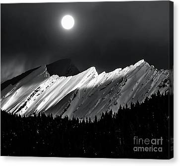 Rocky Mountains In Moonlight Canvas Print by Elaine Hunter
