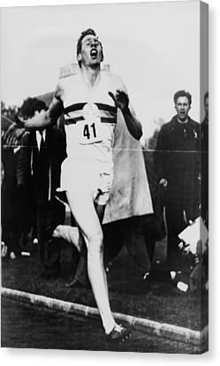 Roger Bannister Crossing The Finish Canvas Print by Everett