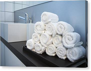 Rolled Towels Stacked In The Shape Of A Pyramid Canvas Print by Larry Washburn