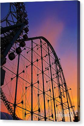 Roller Coaster At Sunset Canvas Print by Eena Bo