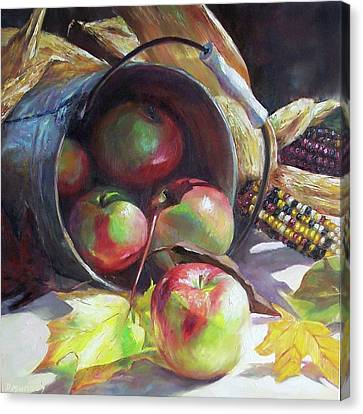 Rolling Apples Canvas Print by Donna Munsch