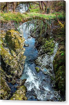 Roman Bridge Canvas Print by Adrian Evans