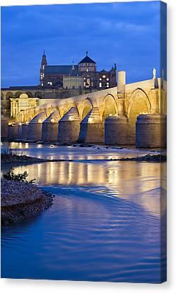Roman Bridge On Guadalquivir River At Dawn Canvas Print by Artur Bogacki